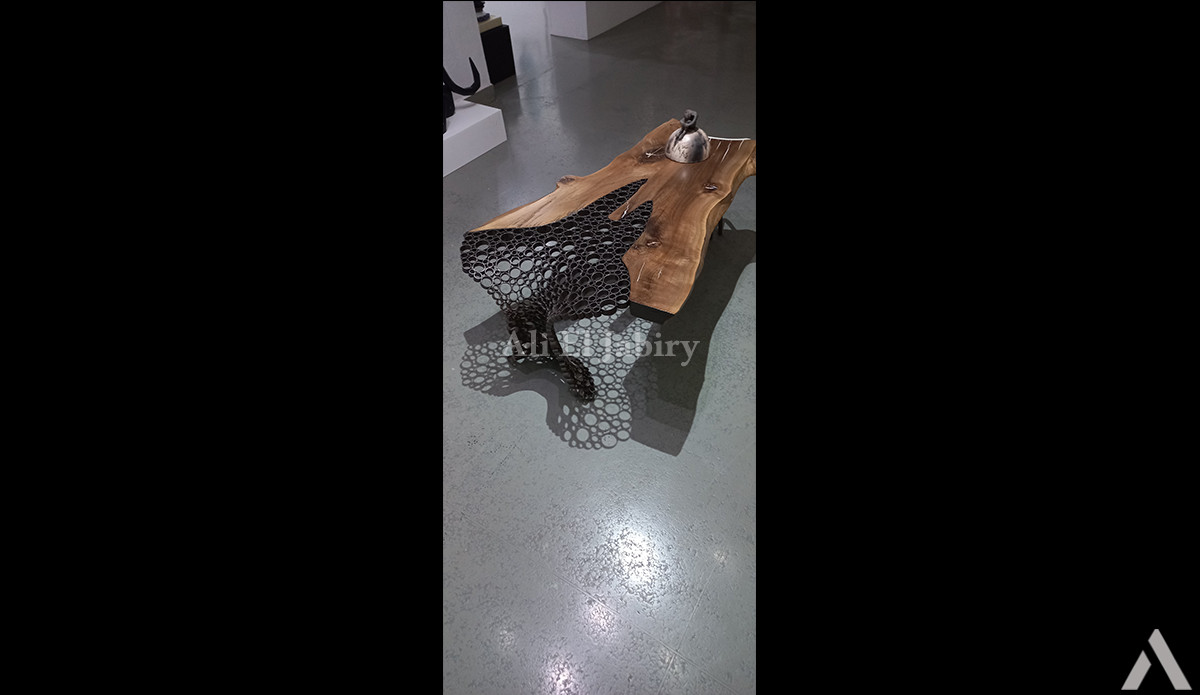 Majestic table in solid wood and cut iron tubes with wrought iron legs