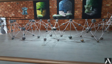 Glass table with threaded iron legs